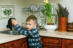 The boy in the kitchen .Portrait indoors Stock Photography
