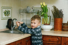 The boy in the kitchen .Portrait indoors Royalty Free Stock Photography