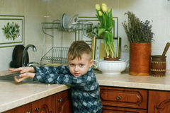 The boy in the kitchen .Portrait indoors Stock Images