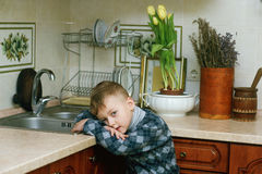 The boy in the kitchen .Portrait indoors Royalty Free Stock Photos