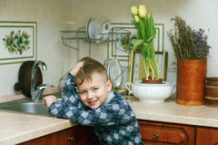 The boy in the kitchen .Portrait indoors Stock Photos