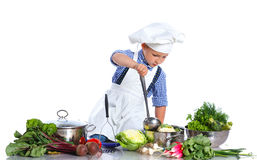 Boy kitchener in chef's hat Stock Images