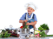 Boy kitchener in chef's hat Stock Photo