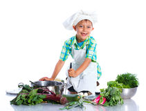 Boy kitchener in chef's hat Stock Photography
