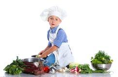Boy kitchener in chef's hat Stock Image