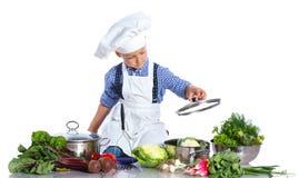 Boy kitchener in chef's hat Stock Photos