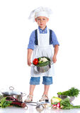 Boy kitchener in chef's hat Royalty Free Stock Photography