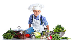 Boy kitchener in chef's hat Royalty Free Stock Image