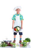 Boy kitchener in chef's hat Royalty Free Stock Photos
