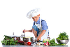 Boy kitchener in chef's hat Royalty Free Stock Images