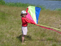 Boy with kite. Boy playing with air toy kite Stock Photography