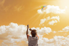 Boy and a kite Stock Photos