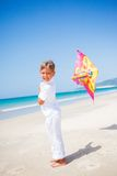 Boy with kite. Summer vacation - Cute boy flying kite beach outdoor Stock Photos