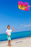Boy with kite. Summer vacation - Cute boy flying kite beach outdoor Stock Photo