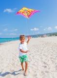 Boy with kite Stock Photos