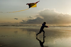 Boy with Kite at sunset. Royalty Free Stock Photo