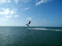 Boy kitesurfing stock photography