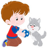 Boy and kitten Royalty Free Stock Images