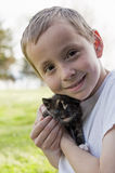 Boy and kitten portrait Royalty Free Stock Photos
