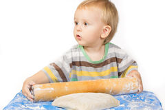 Boy knead the dough by hand for making a cake Stock Photography