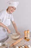 Boy knead the dough Royalty Free Stock Photography