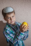 The boy in knitted kippah is holding etrog Royalty Free Stock Photography