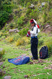 Boy knitting a hat  at Taquile Island in Peru Royalty Free Stock Photography