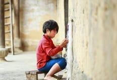 Boy knitting at the North of Vietnam Royalty Free Stock Photo