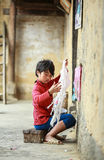Boy knitting at the North of Vietnam Stock Images