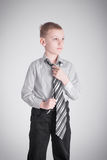 Boy knot tightens Royalty Free Stock Image