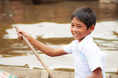Boy of Kompong Phluk rowing boats to come home from school Stock Image