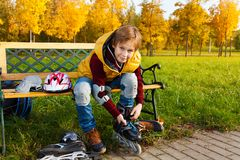 Boy lacing roller skates Stock Photography