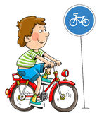 Boy; lad cyclist. The cheerful little boy goes on a bicycle stock illustration