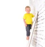 Boy on ladder Royalty Free Stock Image