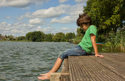 Boy at lake Stock Photo