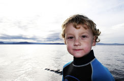 Boy at Lake. Boy in a wetsuit at Lake Taupo, New Zealand Stock Photography