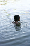 Boy in a lake. Expression man in water royalty free stock photos