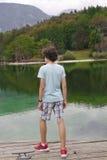 The boy is at Lake bohinj,Slovenia Stock Image