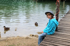 The boy at the lake Stock Photos