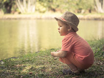 Boy at lakeside Stock Photography