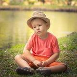 Boy at lakeside Royalty Free Stock Image