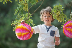 Boy with lampion. Boy with colorful lampion in summer at a party royalty free stock photography