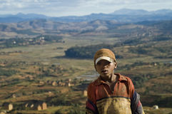 The boy and the landscape. Image of a boy with a typical landscape of Madagascar at his back Royalty Free Stock Image