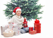The boy with lantern and christmas presents Stock Photography