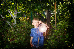 Boy with lantern in his hand in the sundown time. Boy with lantern in hand in the sundown time Royalty Free Stock Images