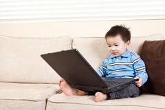 Boy with laptop Stock Photo