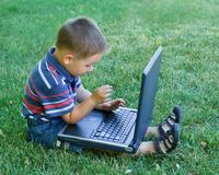 Boy and laptop Royalty Free Stock Photo