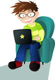 A boy with a laptop Royalty Free Stock Photos