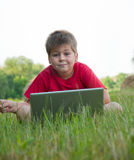 A boy with a laptop Royalty Free Stock Photo