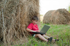 A boy with a laptop Royalty Free Stock Photography